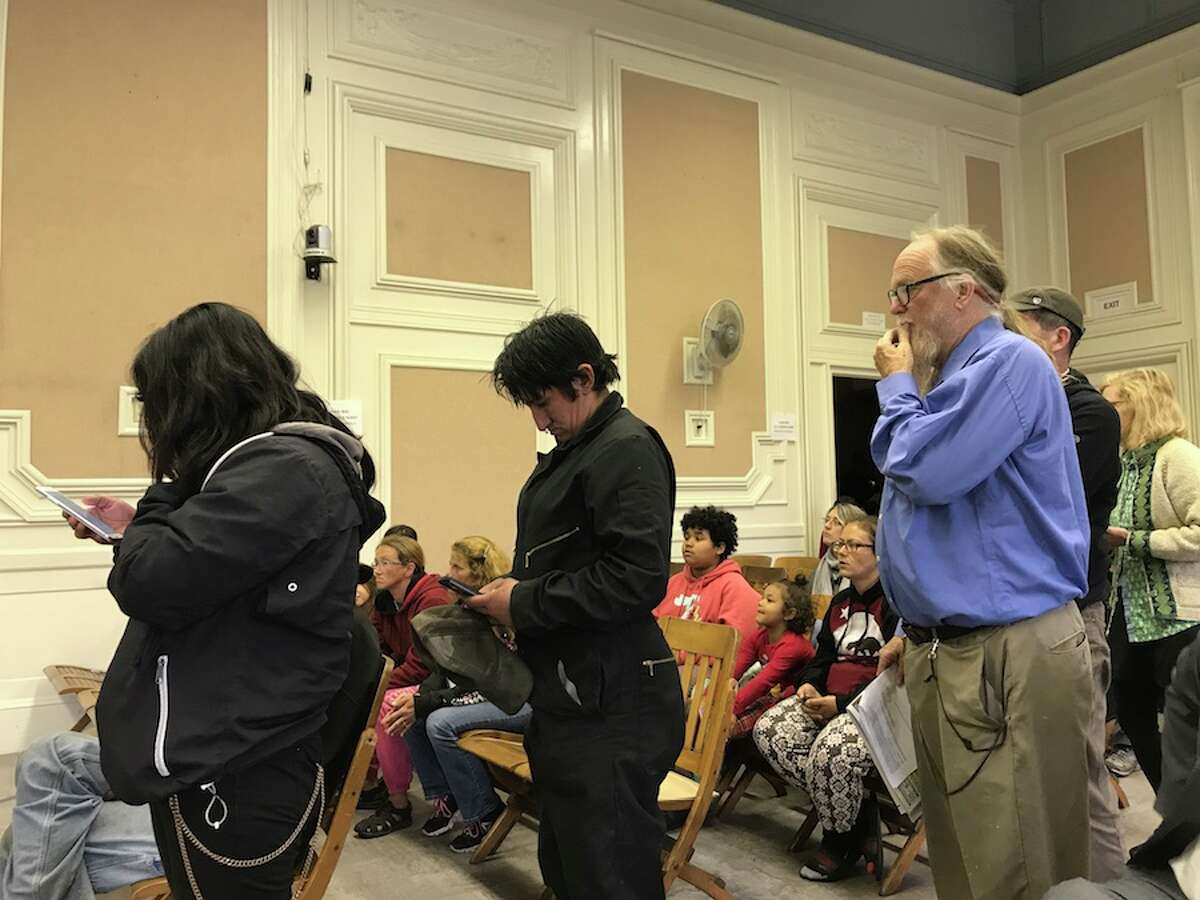 RV dwellers and advocates line up to address the City Council at a special meeting about enforcement of parking rules at the Berkeley Marina.