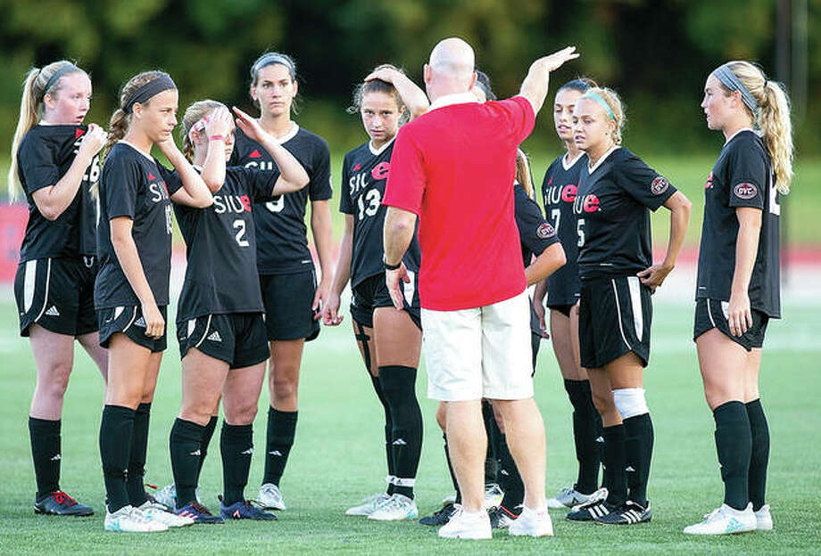 SIUE women's soccer coach Derek Burton gives instructions to his team during halftime of a game last season. the Cougars wil begin their regular season Aug. 17 at the University of Kentucky in Lexington, Ky. Photo:     SIUE Athletics
