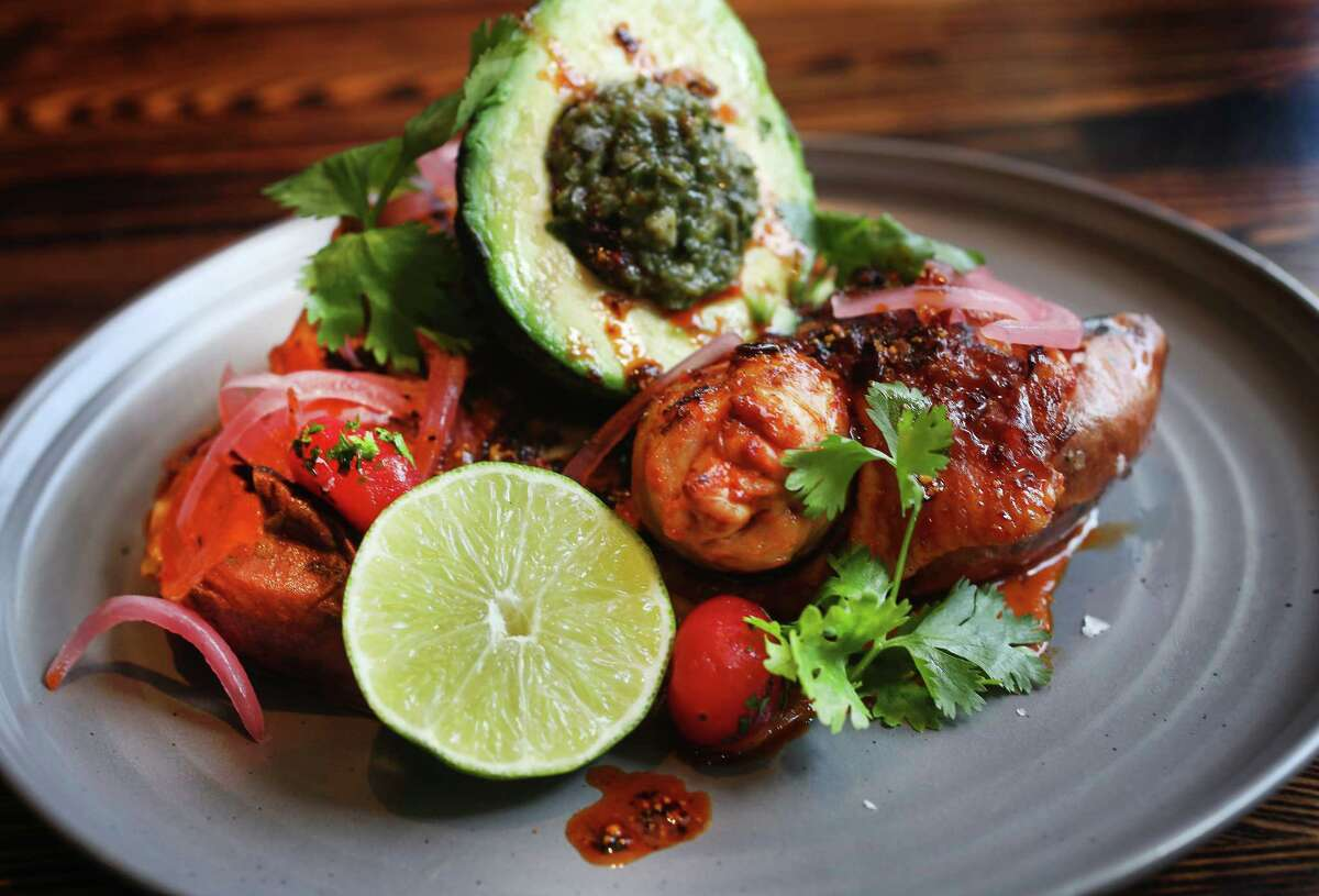 The Sinaloa Chicken flavored with achiote and chiles at International Smoke, opening July 5 at CityCentre.