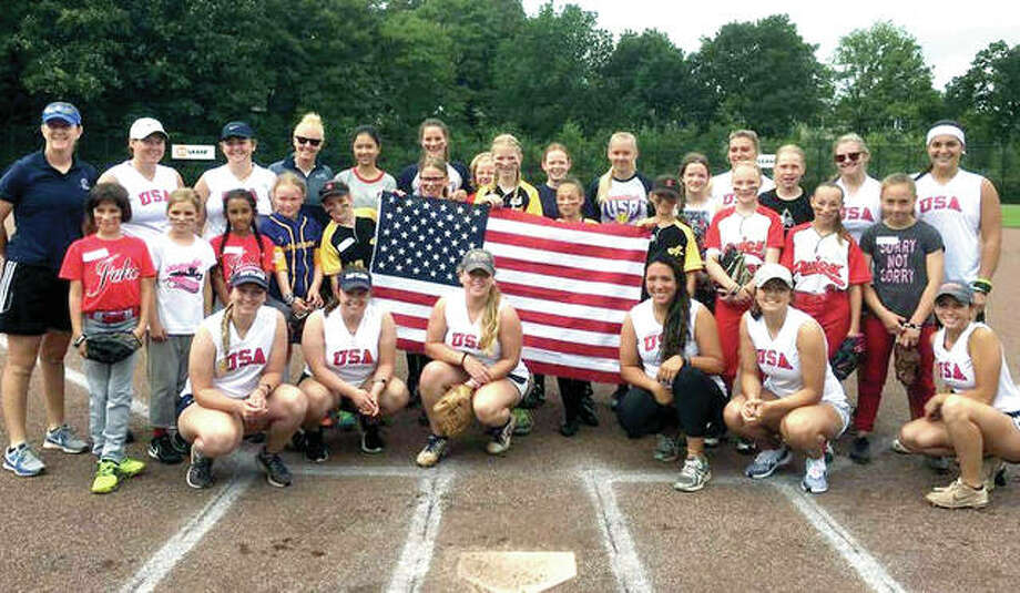 Saint Louis University softball coach Christy Connoyer, far left, and a group that brought softball on a 10-day trip to The Netherlands. Connoyer is a Civic Memorial High product. She previously coached at SIU Carbondale, Purdue and Tulsa after playing at Notre Dame. Photo:       SLU Athletics