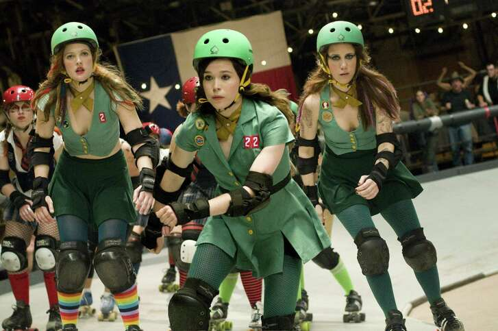 """Drew Barrymore, left, Ellen Page and Kristen Wiig, right, are shown in a scene from, """"Whip It."""""""
