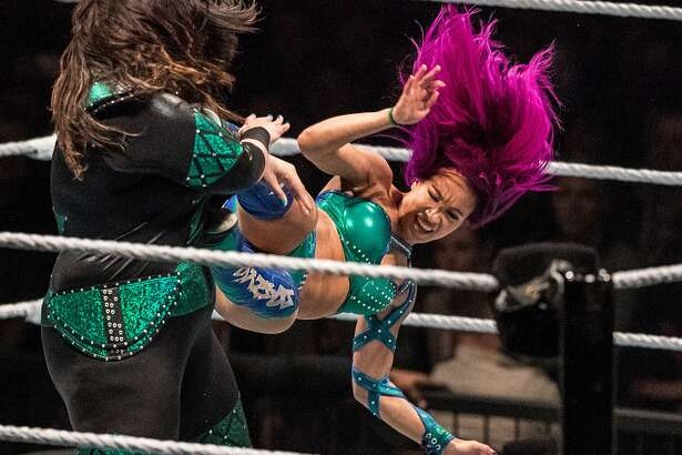 Sasha Banks (right) attacks Nia Jax (left) during the WWE Live Duesseldorf event at ISS Dome on February 22, 2017 in Duesseldorf, Germany.