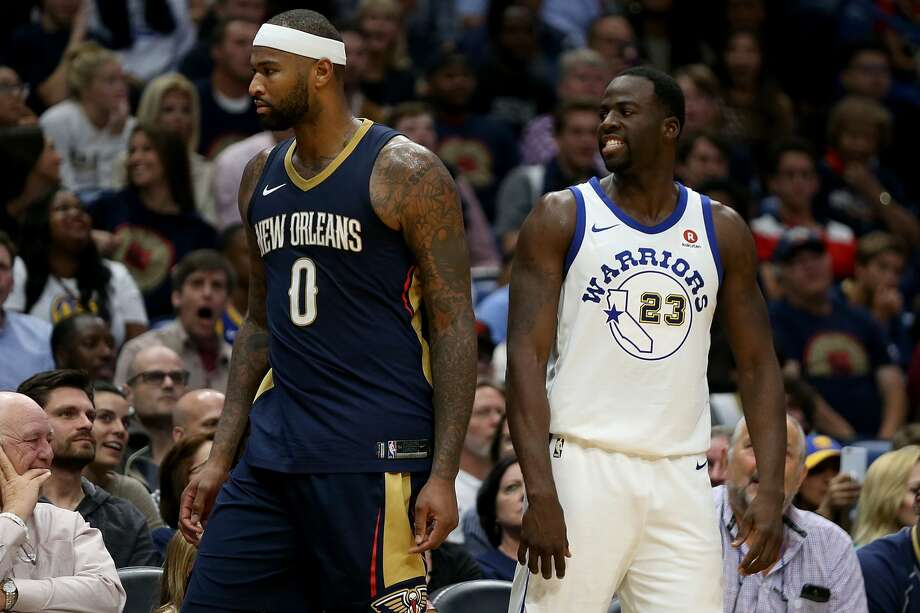 All-star big man DeMarcus Cousins, left, will be joining Draymond Green and the defending champion Warriors after he stunned the NBA universe by agreeing to a one-year contract with Golden State. Photo: Sean Gardner/Getty Images
