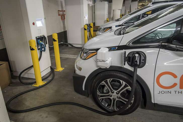 A General Motors Co. Cruise autonomous test vehicle is parked at a new charging station in San Francisco, California, U.S., on Monday, July 2, 2018. Cruise has installed 18 fast chargers in a parking facility on San Francisco's Embarcadero, a busy boulevard along the city's eastern shoreline where Uber Technologies Inc and Lyft Inc. have busy drivers.�Photographer: David Paul Morris/Bloomberg