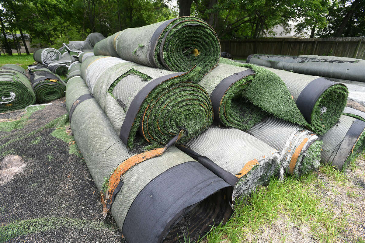 A large pile of synthetic turf from the The Carrol A.