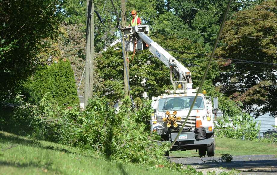 A Frontier Communications crew works to repair lines in September 2016 in Norwalk, Conn. where the company has its headquarters. Photo: Alex Von Kleydorff / Hearst Connecticut Media / Connecticut Post