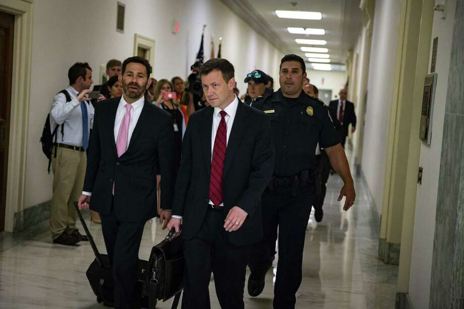 Peter Strzok, center, seen here June 27, has come under scrutiny for a series of anti-Trump texts he sent to former FBI lawyer Lisa Page, with whom he was having an affair. The texts included disparaging comments about then-candidate Donald Trump and his supporters Photo: Bloomberg Photo By Al Drago / Bloomberg