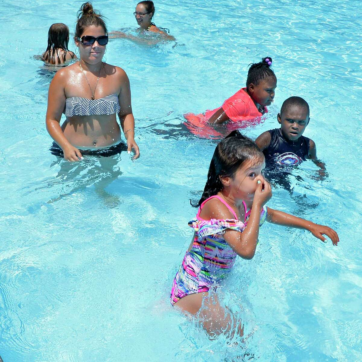 Tiffany Rosencrans keeps a close eye on her five-year-old daughter Aleeah Wertz as she jumps into Lansing Park Pool as her mother Tuesday July 3, 2018 in Cohoes, NY. (John Carl D'Annibale/Times Union)