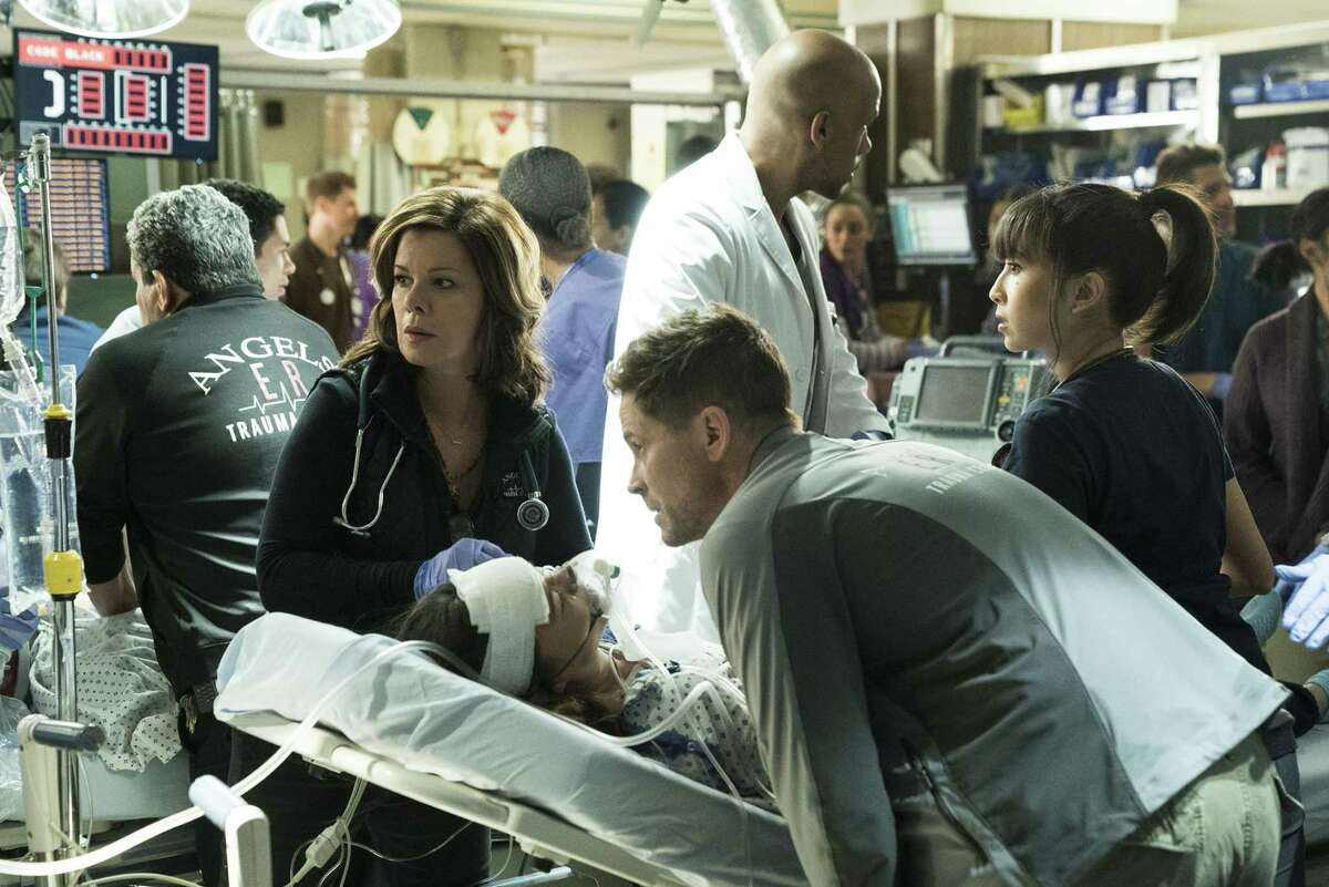 """""""One of Our Own"""" -- While rescuing an injured firefighter, Rox is hit by a drunk driver and rushed to Angels Memorial. Willis begins to realize his feelings for Rox and goes to great lengths to help her. Also, Leanne is excited to tell Ariel good news about her adoption, on CODE BLACK, Wednesday, July 4 (10:00-11:00 PM, ET/PT) on the CBS Television Network. Pictured: Marcia Gay Harden (Dr. Leanne Rorish), Rob Lowe (Col. Ethan Willis) Photo: Sonja Flemming/CBS ©2017 CBS Broadcasting, Inc. All Rights Reserved"""