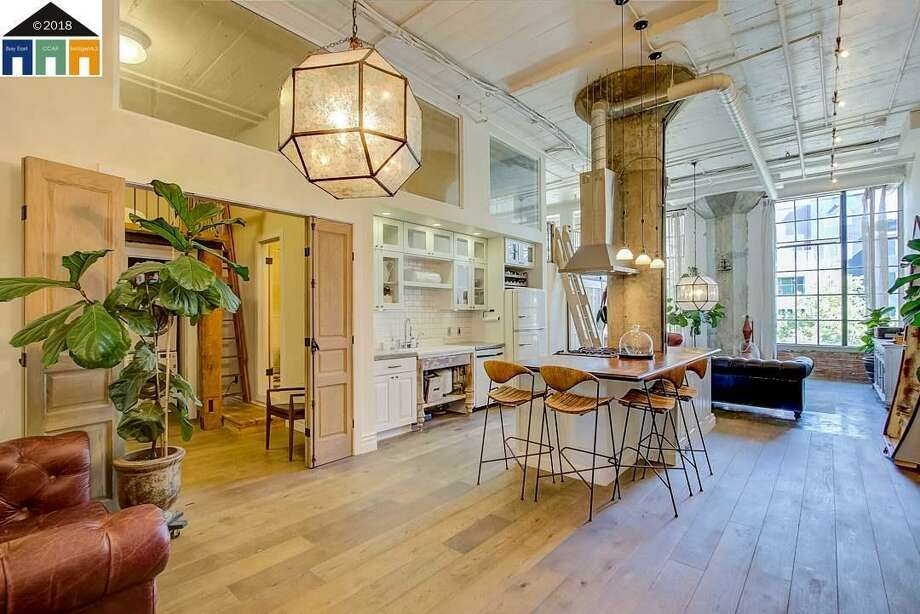 This 1917 loft conversion in Emeryville's Besler Building is a historic property that showcases not only style and charm, but also the city's real estate boom. Asking: $849,500, it will sell for more. Photo: Marc Colwell/Redfin