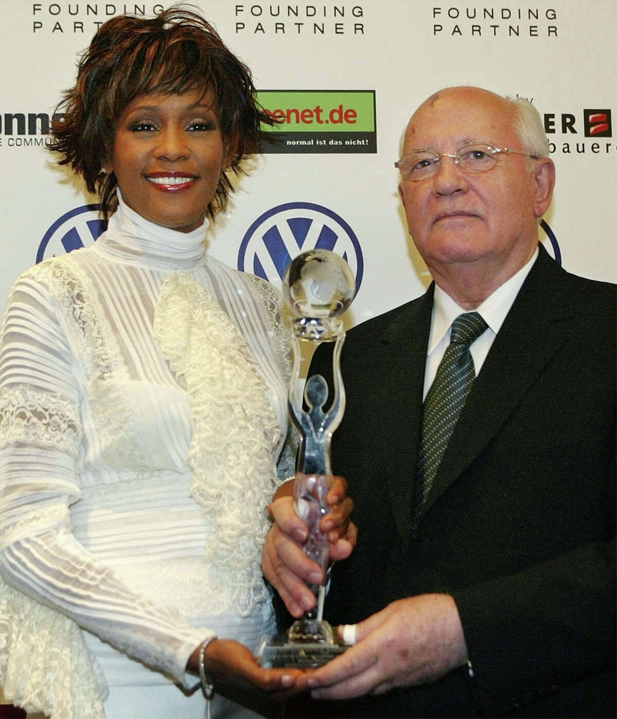 Former Soviet President Mikhail Gorbachev, right, and singer Whitney Houston pose with her award before the beginning of the World Women's Award ceremony in Hamburg's Congress Center, in northern Germany, Wednesday, June 9, 2004 Houston got the World Artist Award for Lifetime Achievement. The Women's World Awards are being presented of the first time this year to extraordinary women in 12 different categories. (AP Photo/Christof Stache, pool)