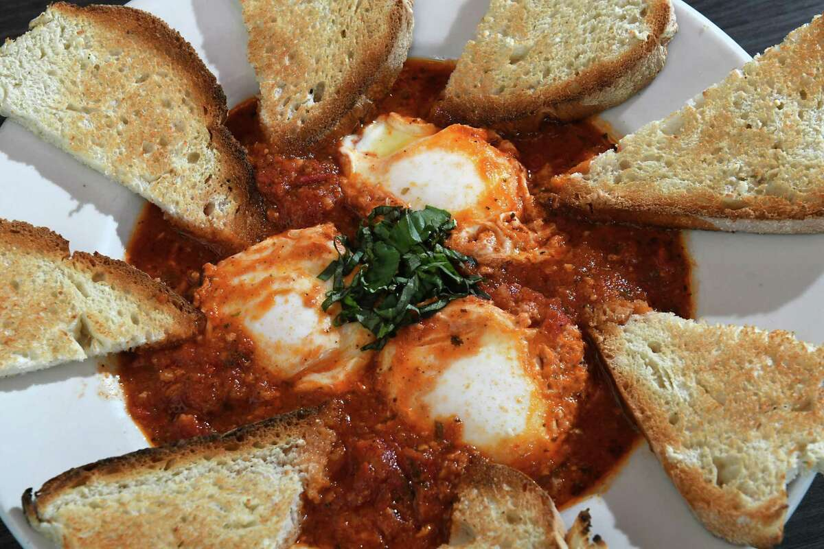 Continue viewing the slideshow to see what Times Union readers called their favorite dishes in Schenectady. Eggs in Purgatory at More Perreca's. (Times Union file photo.)