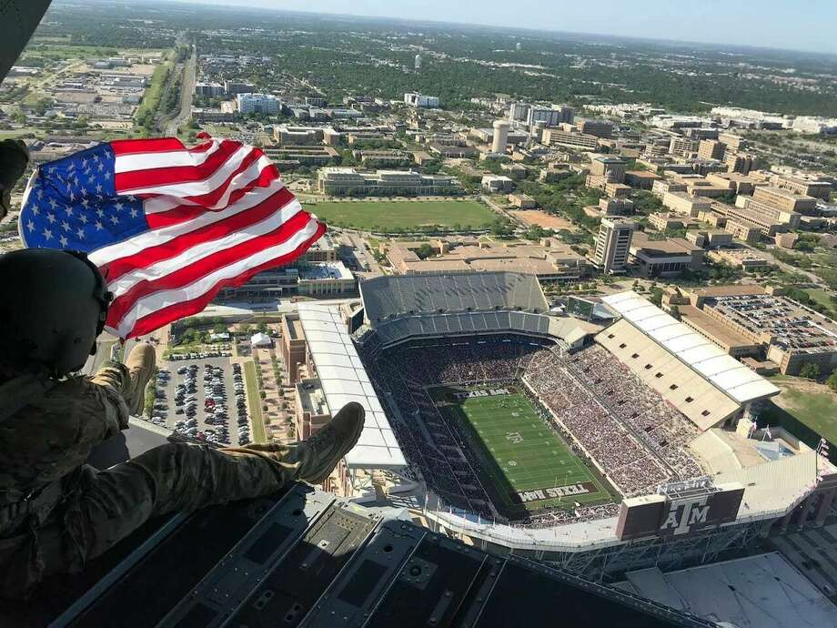 A Chinook pilot unfurled this American flag above Kyle Field for the fans at this year's Texas A&M spring game to see. Photo: Courtesy Foster Lott