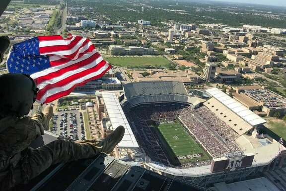 A Chinook pilot unfurled this American flag above Kyle Field for the fans at this year's Texas A&M spring game to see.
