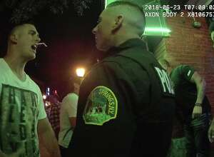 This is a screen grab of footage taken by a Saratoga Springs police officer's body-worn camera in the early morning hours of Saturday, June 23, 2018, outside The Reserve nightclub on Caroline Street. City police arrived to break up a scuffle that allegedly involved four off-duty Saratoga County deputies, who were then suspended from the force three days later. (Video provided by the Saratoga Springs Police Department)