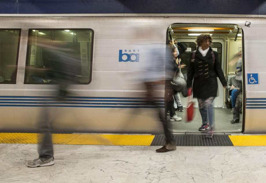 Commuters exit the Bart train at Civic Center Bart Station during the morning rush hour in San Francisco, Calif. Thursday, May 31, 2018. Photo: Jessica Christian / The Chronicle