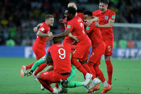 6cbd6995395 England s players celebrate after defeated Colombia in a penalty shoot out  during the round of 16