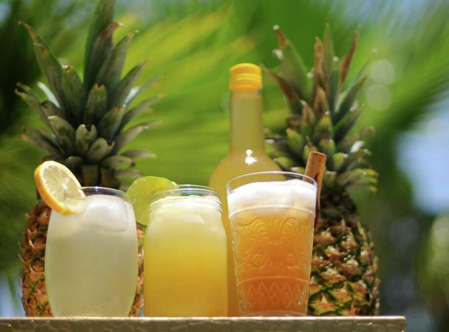 Pineapple stars in a trio of beverages (from left): Pineapple Squash, West African Ginger Pineapple Juice and Tepache. Photo: Paul Stephen / San Antonio Express-News