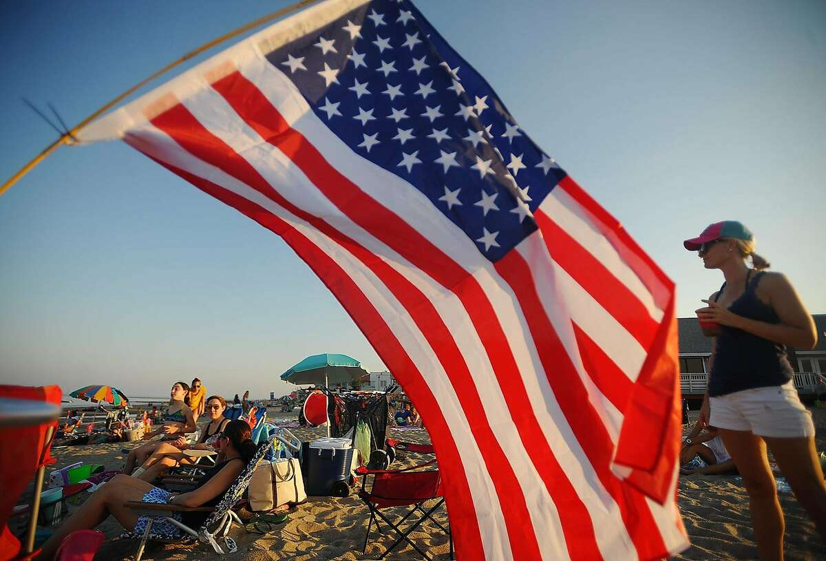An American flag flutters in the breeze during at the Fairfield Fireworks at Penfield Beach in Fairfield, Conn. on Monday, July 2, 2018.