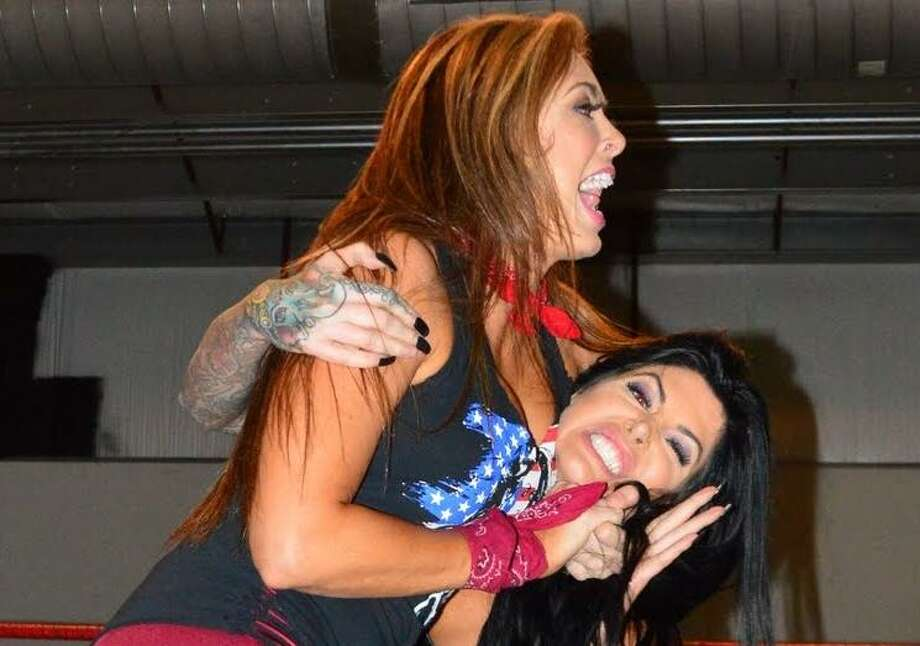 Tanea Brooks, better known as the professional wrestler Rebel (left), said pro wrestling today focuses more on women wrestlers' skills and athleticism, not just their looks. Photo: Courtesy River City Wrestling