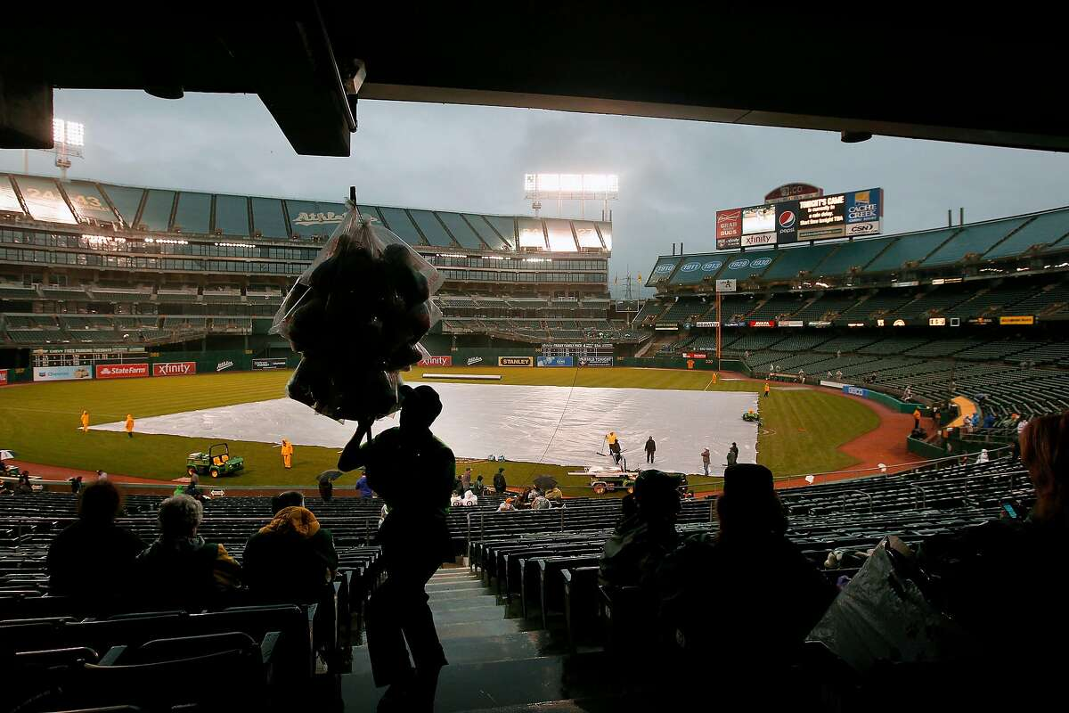A cotton candy vendor works the stands during a rain delay as the Oakland Athletics prepare to take on the Kansas City Royals in major league baseball action at the O.Co Coliseum on Tuesday April 10, 2012, in Oakland, Ca.