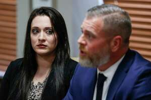 Brie Ana Williams, left, who was raped during the Los Vaqueros Rio Grande Trail Ride in 2012, sits next to her attorney, Chad Pinkerton, during a press conference Tuesday, July 3, 2018 in Houston. Williams is suing the Houston Livestock Show and Rodeo for $10 million and the rodeo has countersued, claiming they should not be a party in the lawsuit and should therefore not be compelled to release their charity records.