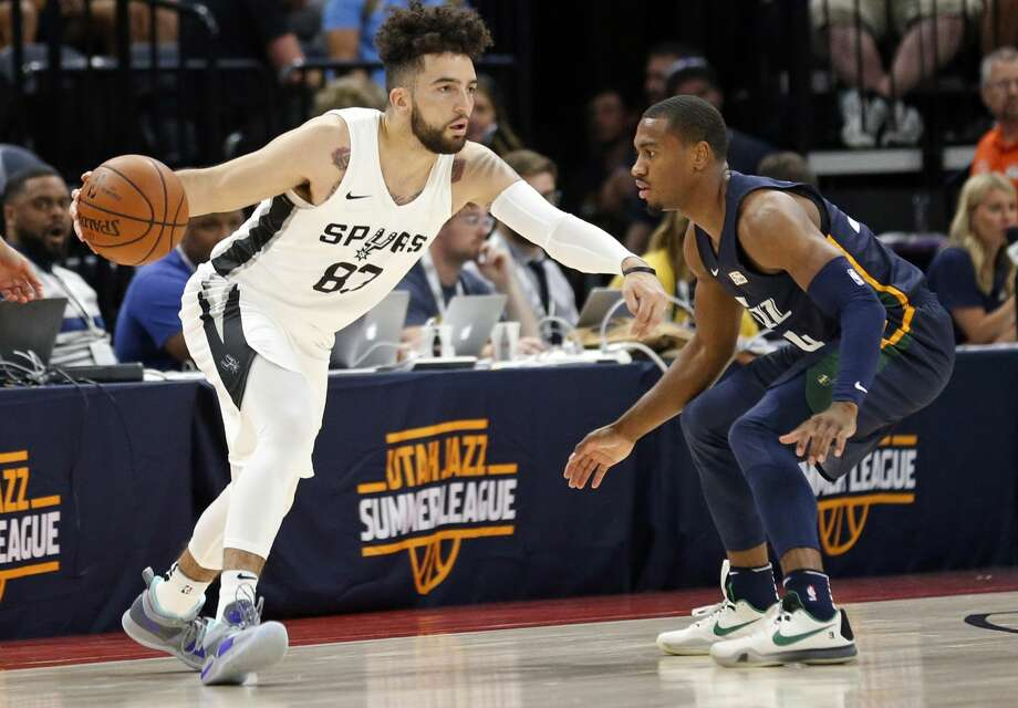 San Antonio Spurs guard London Perrantes (83) drives as Utah Jazz guard Trey Lewis (34) defends during the first half of an NBA summer league basketball game Monday, July 2, 2018, in Salt Lake City. (AP Photo/Rick Bowmer) Photo: Rick Bowmer/Associated Press