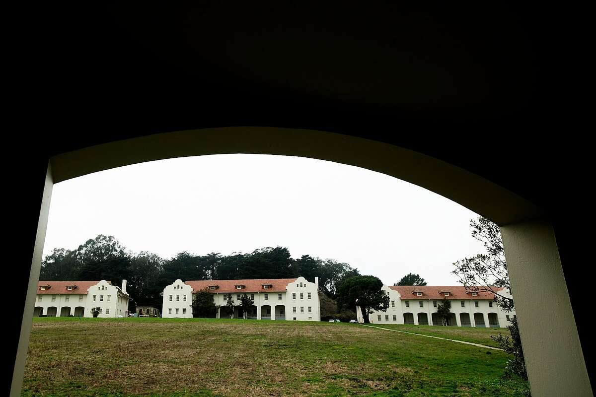 Buildings surround a lawn at Fort Scott in the Presidio on Wednesday, Jan. 17, 2018, in San Francisco. The Presidio Trust hopes to find a developer to revitalize the area.