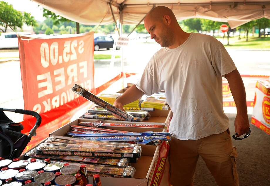Jason Faucher, of Monroe, shops for fireworks for the 4th of July holiday at the Keystone Fireworks tent at the Connecticut Post Mall in Milford, Conn. on Tuesday, Julky 3, 2018. Photo: Brian A. Pounds / Hearst Connecticut Media / Connecticut Post