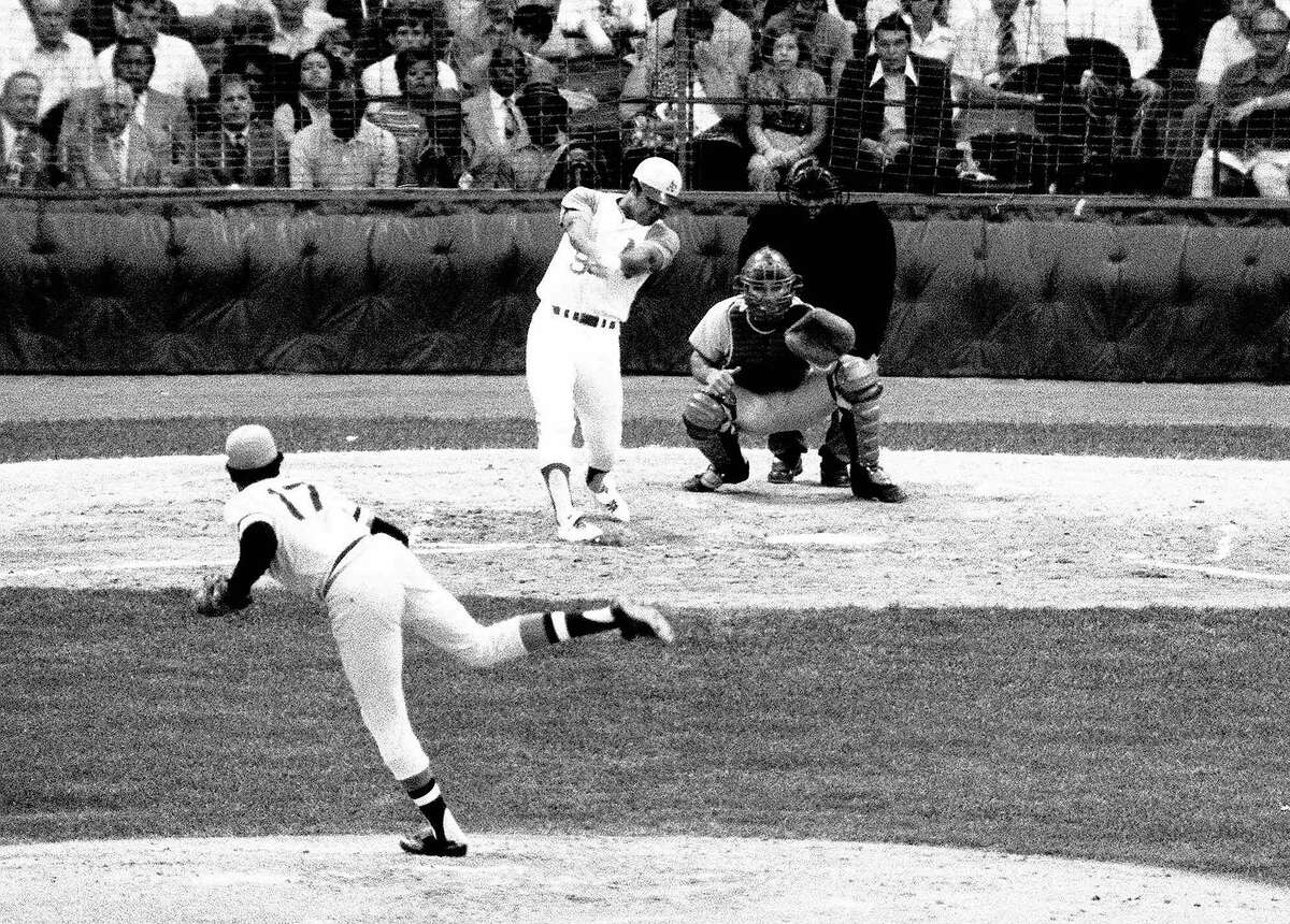 The American League's Reggie Jackson follows through on a towering third inning home run with a man on base in All-Star game in Detroit on July 13, 1971. National League pitcher is Dock Ellis of the Pittsburgh Pirates and catcher is Johnny Bench. Jackson's jolt started an American league comeback after Bench's second inning homer got the National League on the scoreboard. The Amercan League won the game 6-4, with two run homers by Jackson, Frank Robinson, and Harmon Killebrew. (AP Photo) Ran on: 07-03-2007 Reggie Jackson tagged a Dock Ellis pitch for a two-run, pinch-hit homer in the third inning.