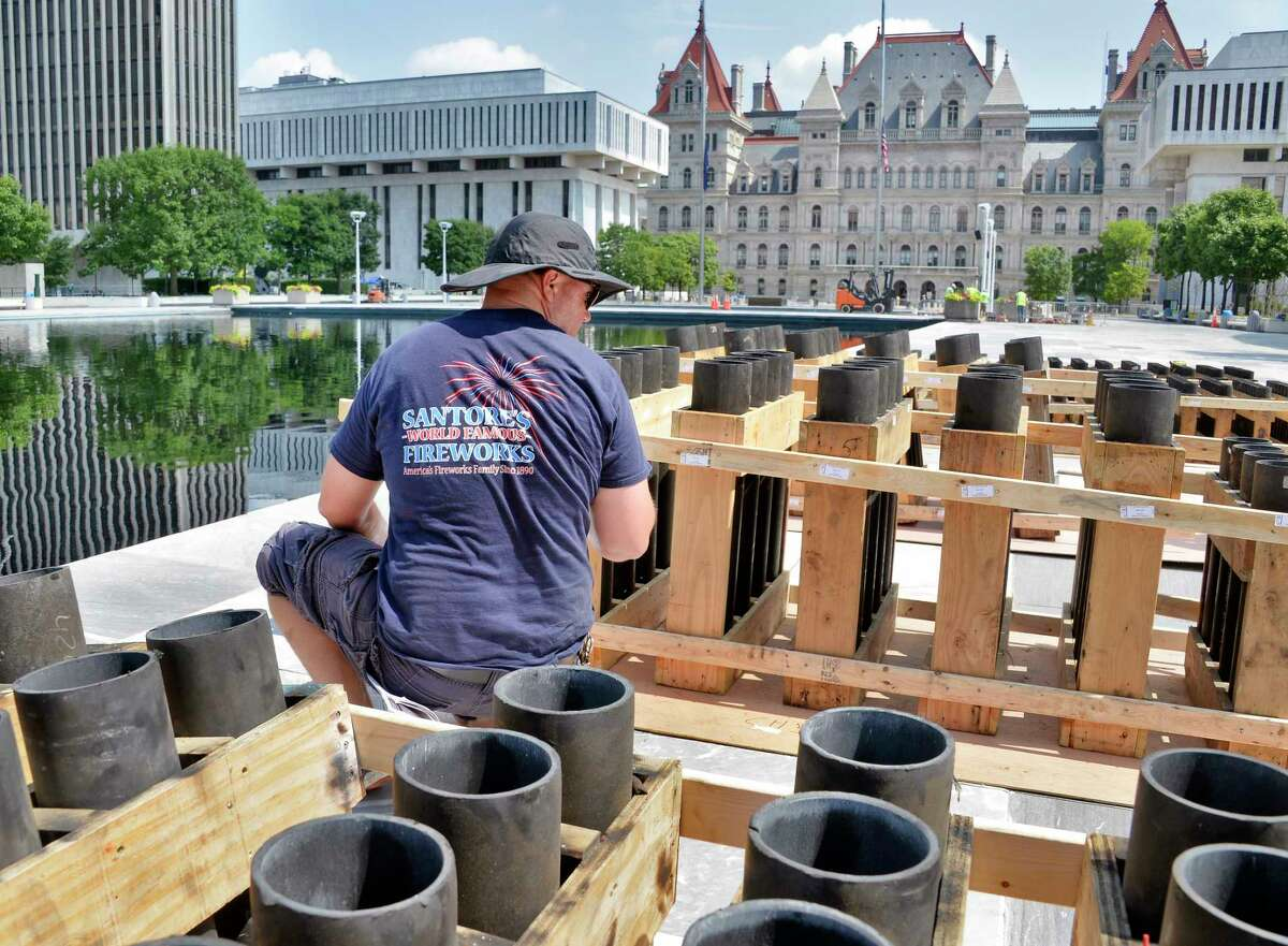 Pyrotechnician Mike Ciulla of Santore's World Famous Fireworks of Schaghticoke labels racks of launching tubes during setup for the Fourth of July celebration at the Empire State Plaza Tuesday July 3, 2018 in Albany, NY. (John Carl D'Annibale/Times Union)