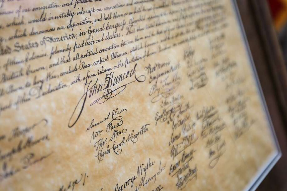 John Hancock's signature on a Declaration of Independence replica. Photo: Michael Minasi / Houston Chronicle / © 2017 Houston Chronicle