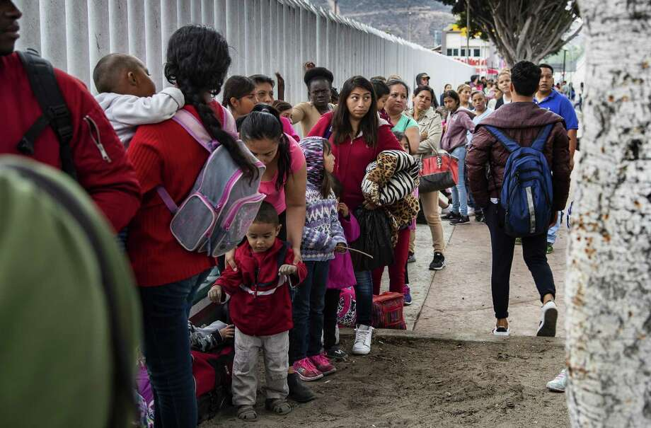 Asylum-seeking immigrants line up in Tijuana, Mexico. Any fix to immigration should keep such families together and give them hearings even if it means deporting the entire family unit. Photo: Gina Ferazzi /TNS / Los Angeles Times