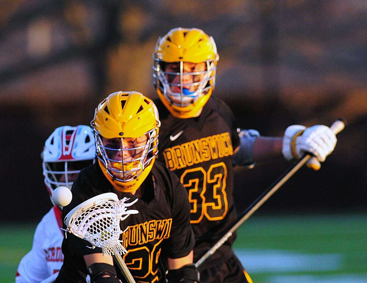 Brunswick's Chris Burdick, front, earned US Lacrosse Academic All-America honors.