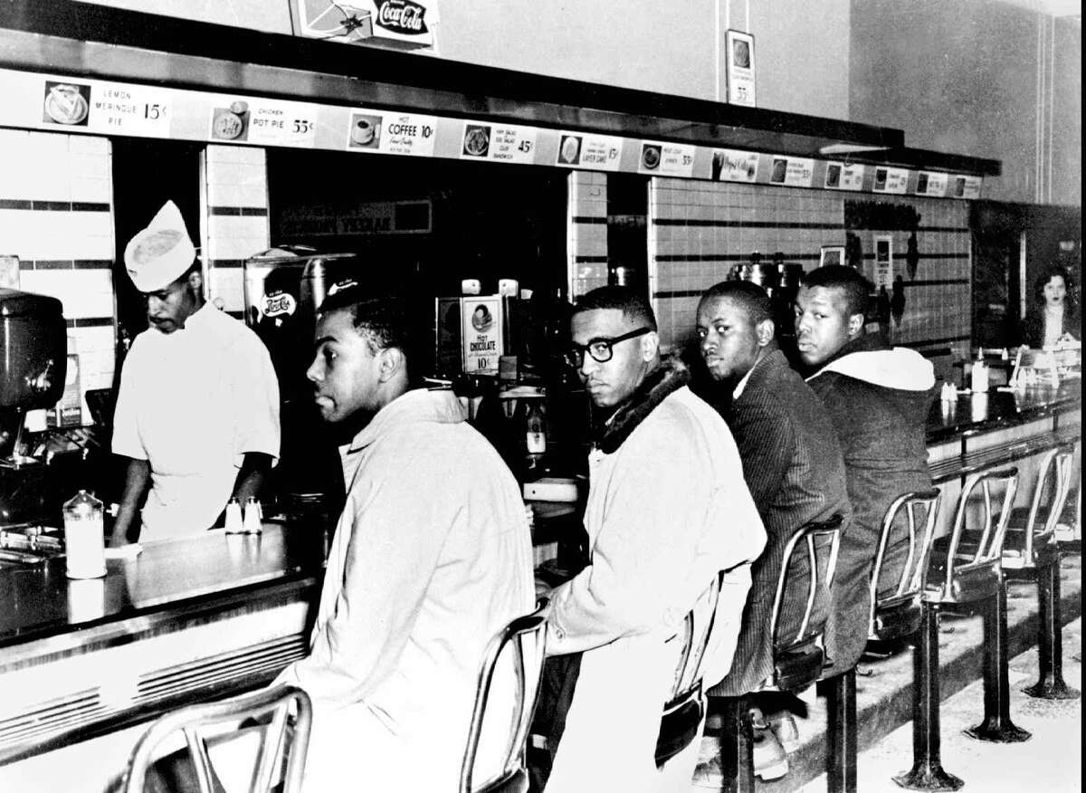 Four A&T College students sit down at the F.W. Woolworth Co. lunch counter on Feb. 1, 1960 in Greensboro, N.C., where they were refused service. The incident helped to energize the American civil rights movement. From left are Joseph McNeil, Franklin McLain, Billy Smith and Clarence Henderson.