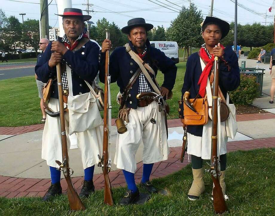 The Sable Soldiers of the American Revolution reenact battles. Photo: Contributed Photo