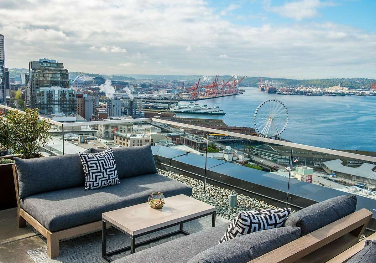 The far-reaching vistas are part of the appeal of the Nest, the rooftop bar and lounge of Thompson Seattle.