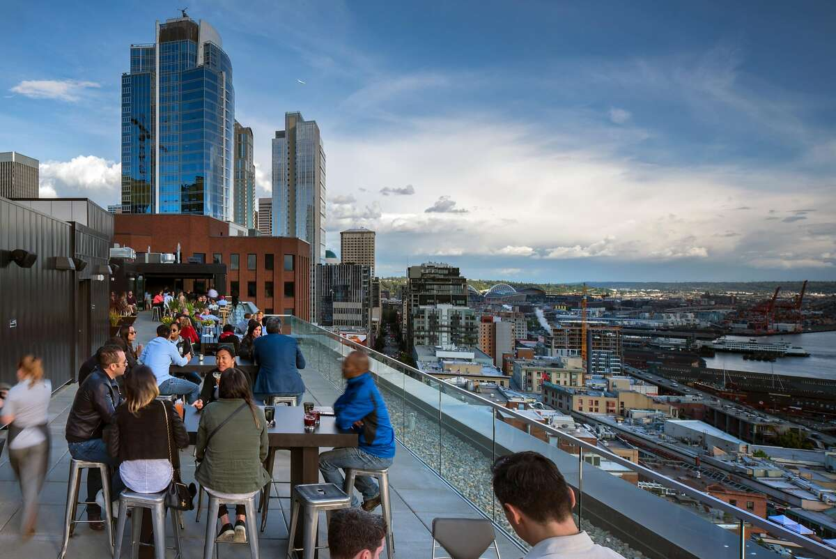 The Nest, the rooftop bar and lounge of Thompson Seattle, draws a mix of locals and visitors.