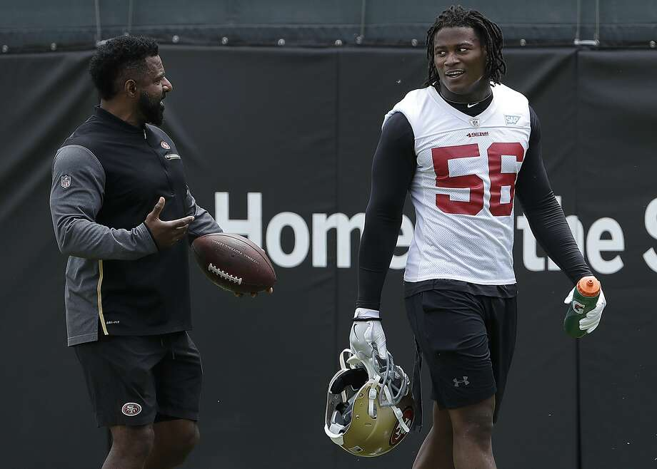 FILE - In this May 30, 2018, file photo, San Francisco 49ers linebacker Reuben Foster (56) walks on the field with assistant coach Ray Wright during a practice at the team's NFL football training facility in Santa Clara, Calif. Photo: Jeff Chiu / Associated Press