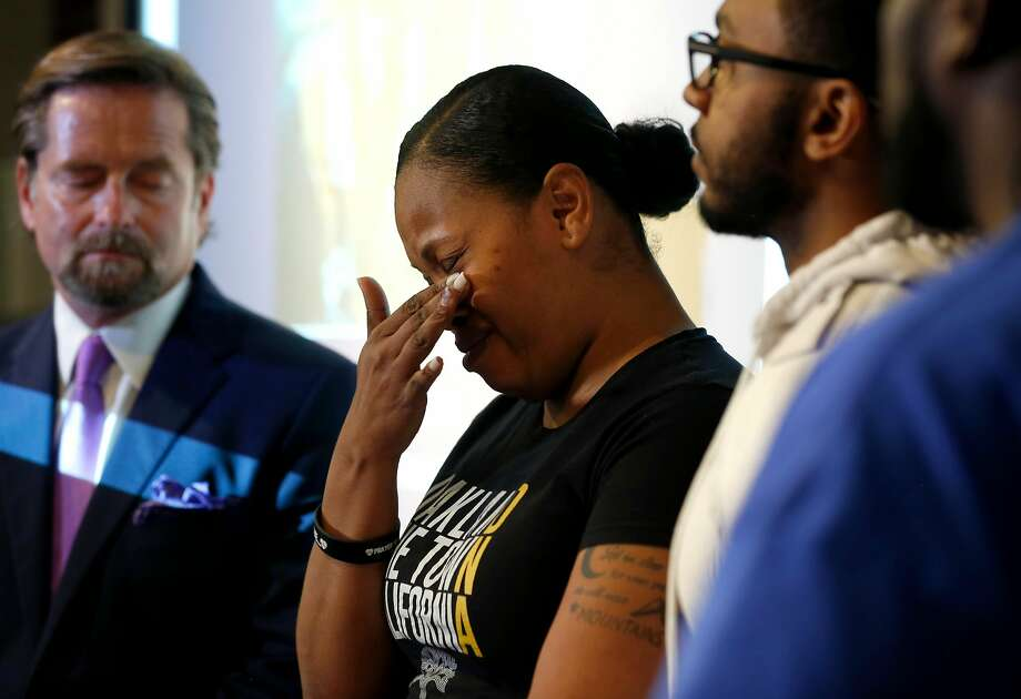 Nailah Winkfield appears at a news conference with her attorney Christopher Dolan (left), her brother Omari Sealey and husband Marvin Winkfield to discuss the death of her daughter Jahi McMath in San Francisco, Calif. on Tuesday, July 3, 2018. Photo: Paul Chinn / The Chronicle
