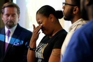 Nailah Winkfield appears at a news conference with her attorney Christopher Dolan (left), her brother Omari Sealey and husband Marvin Winkfield to discuss the death of her daughter Jahi McMath in San Francisco, Calif. on Tuesday, July 3, 2018.