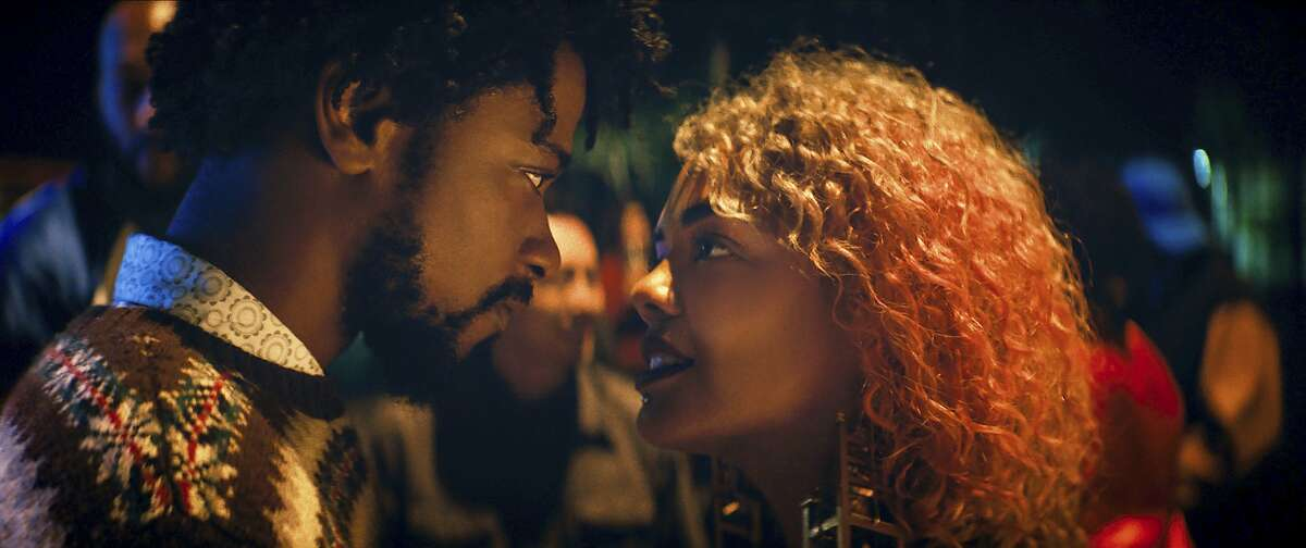 """In this image released by Annapurna Pictures, Lakeith Stanfield, left, as Cassius Green and Tessa Thompson as Detroit star in """"Boots Riley's """"Sorry to Bother You,"""" an Annapurna Pictures release. The film opens Friday, July 6, 2018. (Annapurna Pictures via AP)"""