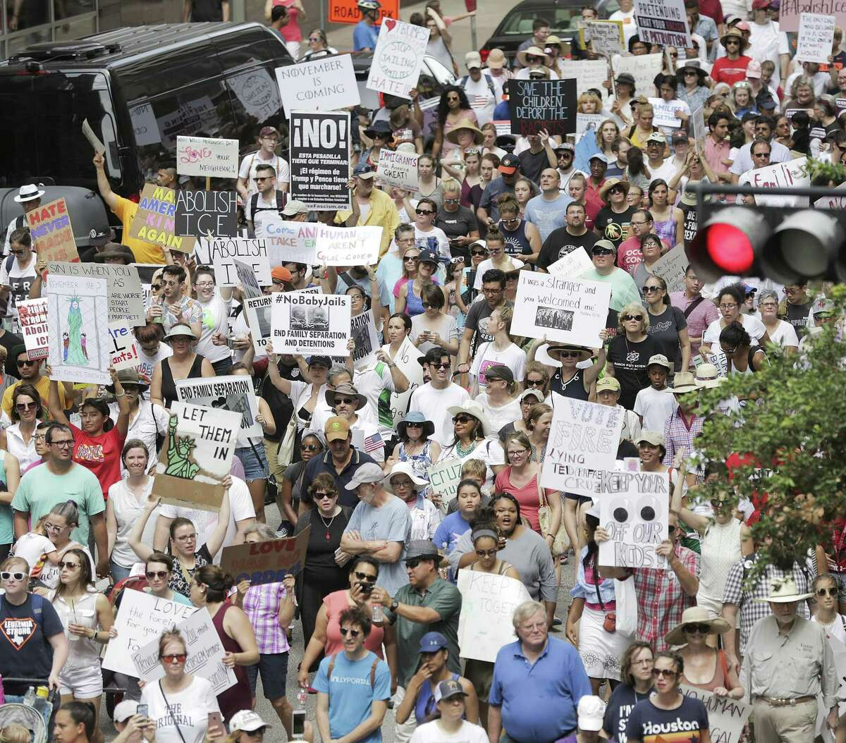 """Protestors fill Walker Street as they march for immigration reform in Houston on Saturday, June 30, 2018 in Houston. Rallies were held across the nation calling on federal agencies to reunite families separated at the border under Trump's """"zero tolerance"""" policy, as well as calling for the abolishment of ICE. (Elizabeth Conley/Houston Chronicle)"""