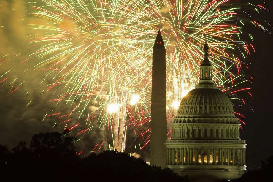 Fireworks illuminate the sky over the U.S. Capitol building and the Washington Monument during 2014 Fourth of July celebrations in Washington. Photo: Evan Vucci, STF / Associated Press / Copyright 2018 The Associated Press. All rights reserved.