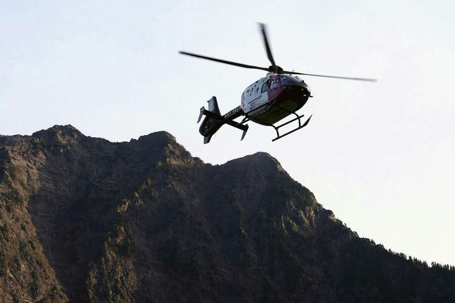 """In this July 6, 2015, photo a helicopter transports an injured woman to a hospital near the Big Four trail head in Verlot, Wash. Air ambulances transport around 400,000 people each year in the U.S., according to industry estimates. Most trips are from one hospital to another. But they also play a vital role in getting seriously injured or ill people fast help during what doctors call the golden hour,"""" the initial window after an accident when a patients chances for recovery are better. Photo: Genna Martin /Associated Press / The Herald"""