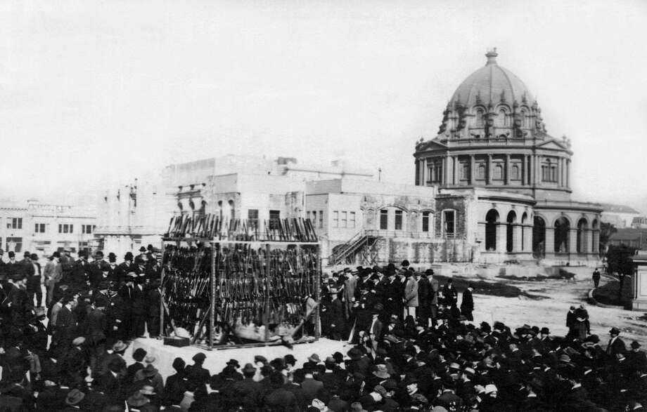 FILE-- Thousands of dollars worth of opium and opium layouts are about to be destroyed by fire in front of City Hall during the SF crusade against opium usage, San Francisco in 1914. The fire was supervised by Mayor Rolph in the presence of thousands of spectators and hundreds of city officials. Photo: Underwood Archives/Getty Images