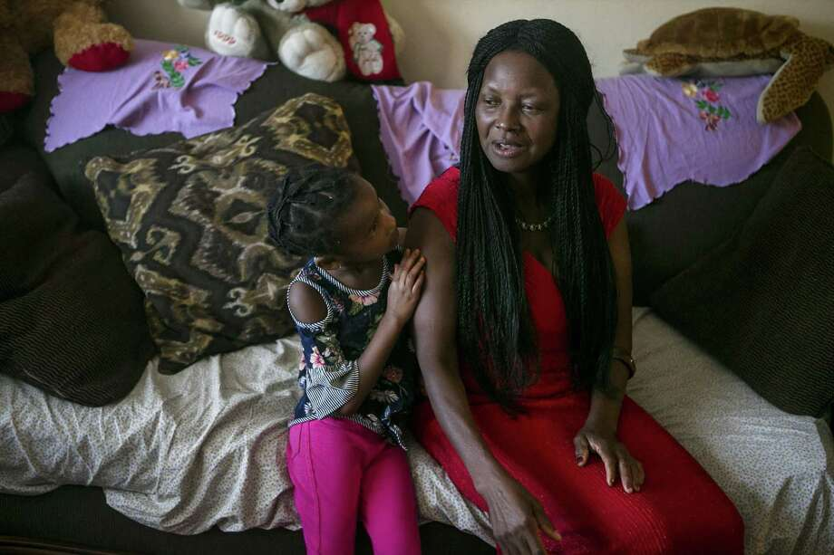 Josephine Toundamje talks about her and her family's journey to America from Chad as her grand daughter Jasmine Dilla, 4, listens at Toddamds San Antonio apartment June 27, 2018. Toddamds was happy to learn that her country Chad had been removed from President Trump's travel restriction list, but she still feels sad that the Supreme Court upheld the administration's travel ban against several Muslim majority countries. Photo: Josie Norris /San Antonio Express-News / © San Antonio Express-News