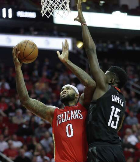 Houston Rockets center Clint Capela (15) defends against New Orleans Pelicans center DeMarcus Cousins (0) during the second half of an NBA game at Toyota Center, Monday, Dec. 11, 2017, in Houston.  ( Karen Warren / Houston Chronicle ) Photo: Karen Warren, Staff / Houston Chronicle / © 2017 Houston Chronicle