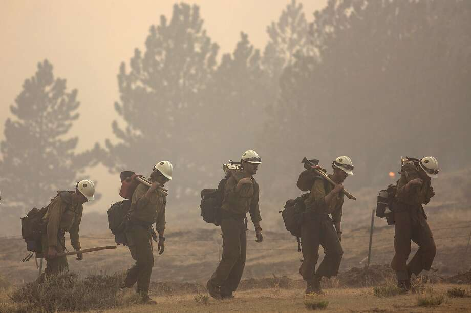 Members of the Craig Hotshots firefighters return from battling the Weston Pass Fire, Monday, July 2, 2018, near Fairplay, Colo. In Colorado, more than 2,500 homes were under evacuation orders as firefighters battled more than a half-dozen wildfires. (Hugh Carey/Summit Daily News via AP) Photo: Hugh Carey, Associated Press