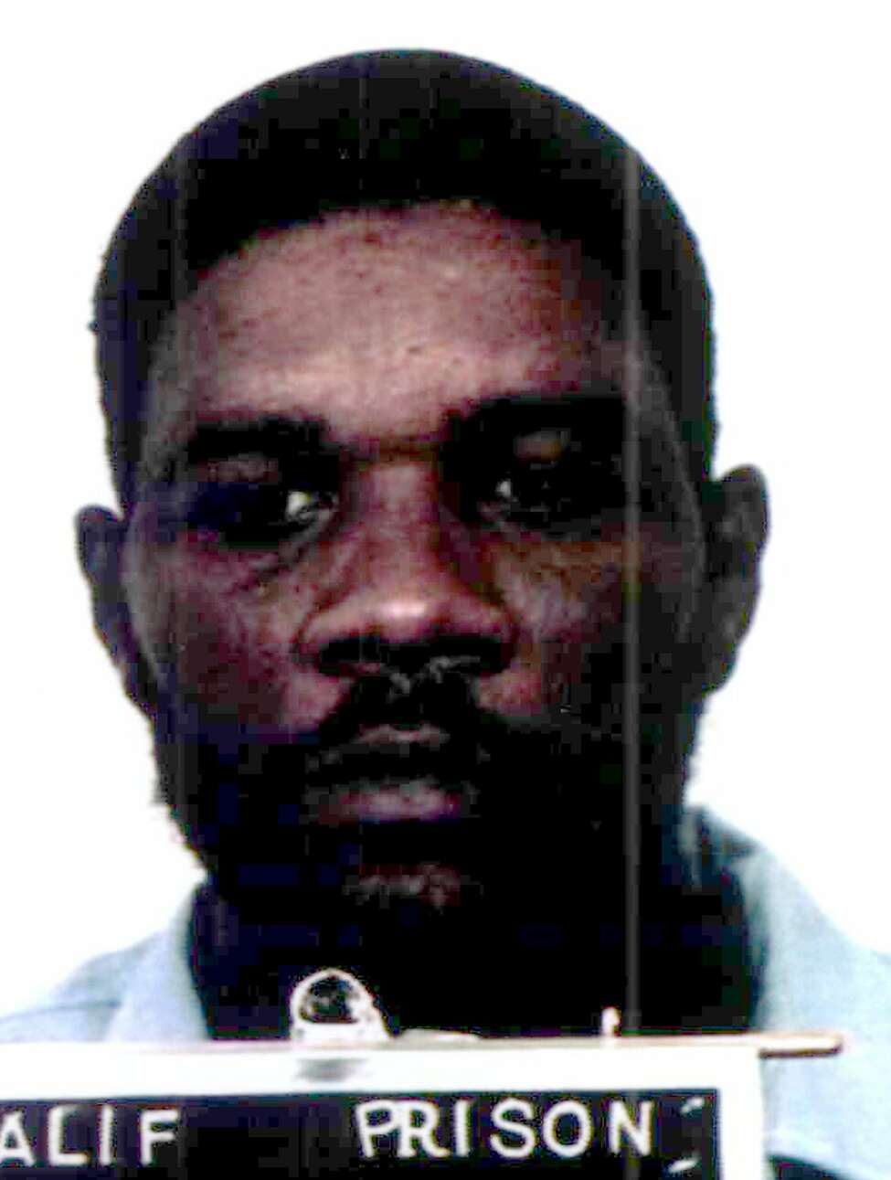 This is an undated California Department of Corrections handout photo of Kevin Cooper.